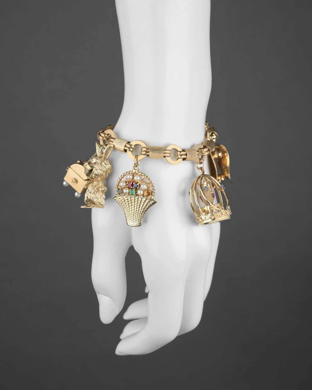 Whimsical 14k Yellow Gold Charm Bracelet Composed Of Flat Open Circular And Textured Barrel Shaped Links Suspending Eight Vintage
