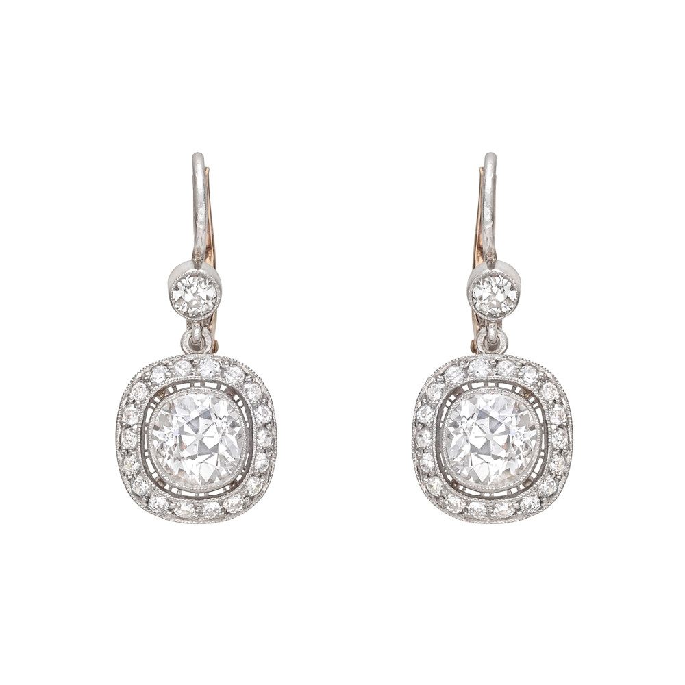 Diamond Drop Earrings Suspending Two Old Mine Cut Diamonds Weighing Roximately 2 15 Total Carats With A Pavé Surround And Single Circular
