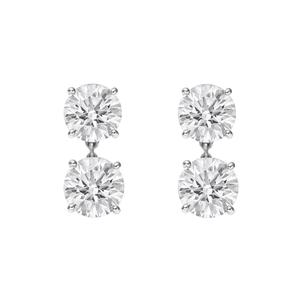 bd8c4293f Round brilliant cut double drop stud earrings in platinum. Two matching,  near-colorless diamonds on top weighing 1.46 total carats (both G-color and  ...