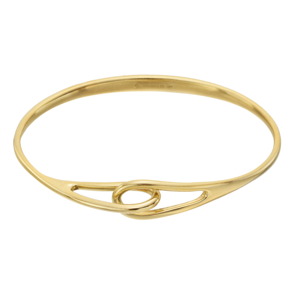 a34de7fc9 Oval-shaped, bangle, designed with an entwined double loop motif in the  front, signed Tiffany & Co. Medium size.