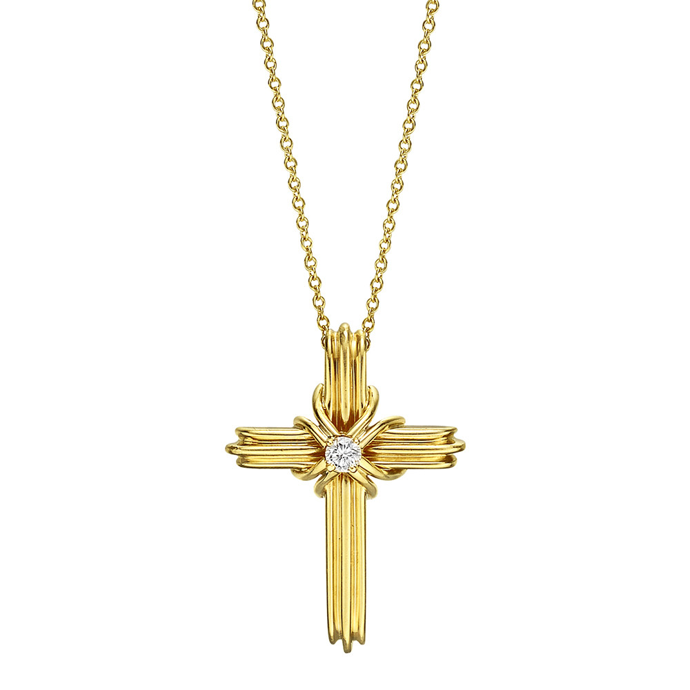 Estate tiffany co 18k gold diamond cross pendant necklace cross pendant in ribbed 18k yellow gold centering a round diamond weighing approximately 010 carats f g colorvvs1 vvs2 clarity within a wrapped gold aloadofball Gallery