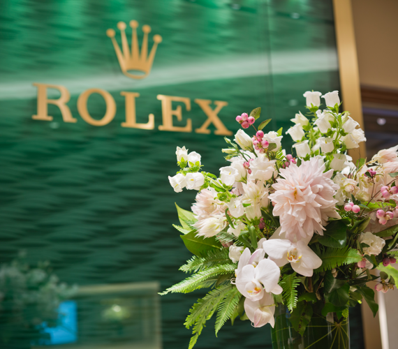 Rolex logo with flowers
